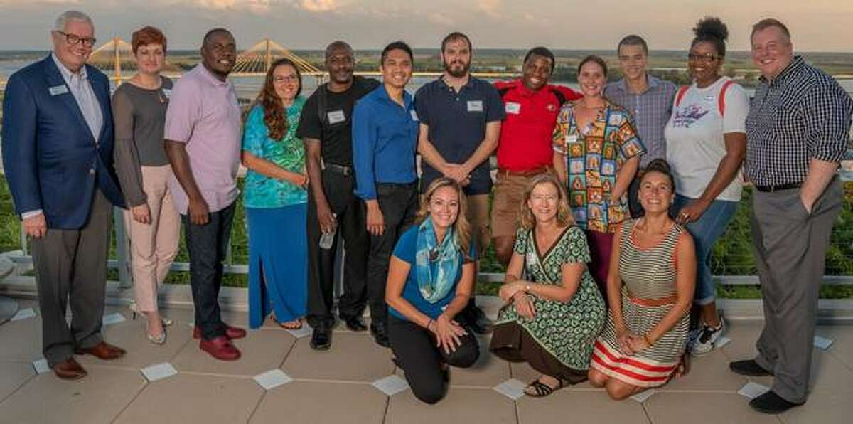 Presenters at Alton Main Street's 2018 Pitch Competition included, standing from left, Charlie Hoffman, Trudy Bodenbach, Chris Harris, April Gray, Joshua Young, Rey Castuciano, Joe Moran, Bryon Dawayne Pierson Jr., Nicole Gory, Nico Stranquist, Jaquisha Brumfield and Chris Miller; kneeling from left, Maggie Partipilo, Christine Ilewski-Huelsmann and Sara McGibany.