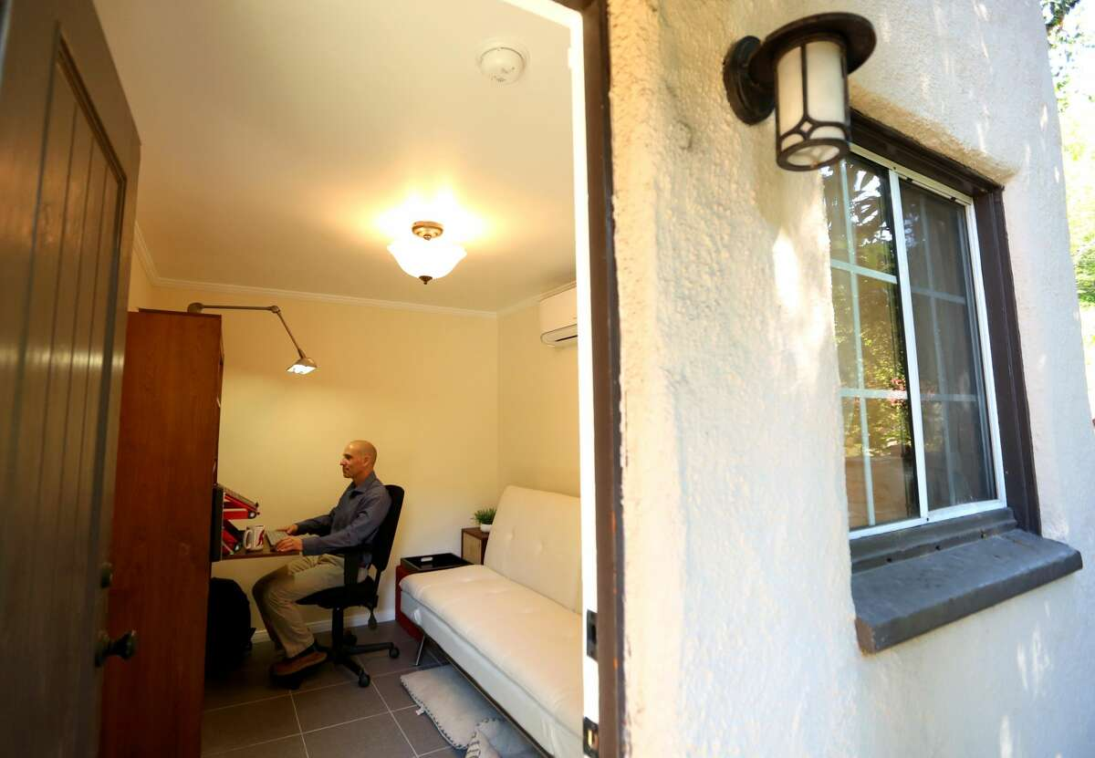 Dr. Steven Siegel, a psychiatrist and Chair of the Department of Psychiatry and Behavioral Studies with the Keck School of Medicine at USC, works in his office at home in Glendale on April 24, 2020. (Genaro Molina / Los Angeles Times via Getty Images)