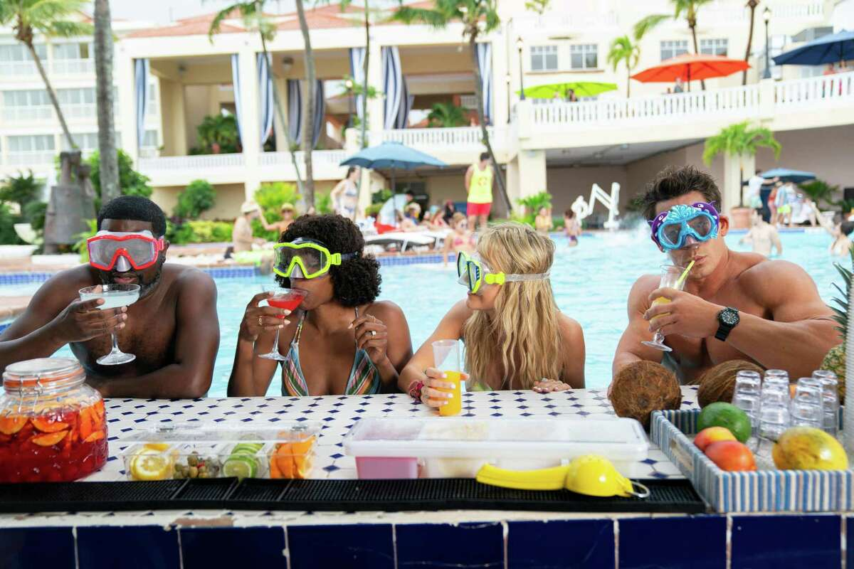 """From left, Lil Rel Howery, Yvonne Orji, Meredith Hagner and John Cena in """"Vacation Friends."""""""