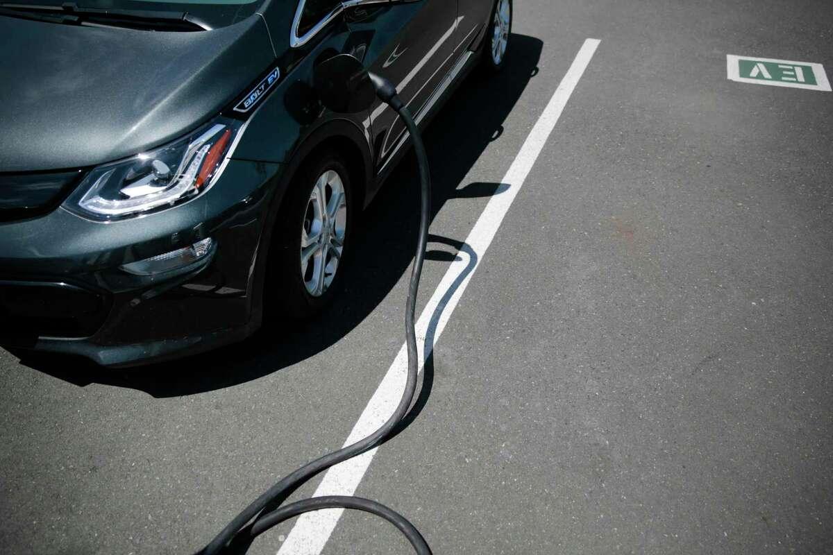 A 2017 Chevy Bolt electric vehicle charging at the Jim Bone Kia dealership in Santa Rosa, Calif. on Thursday, May 3, 2018.