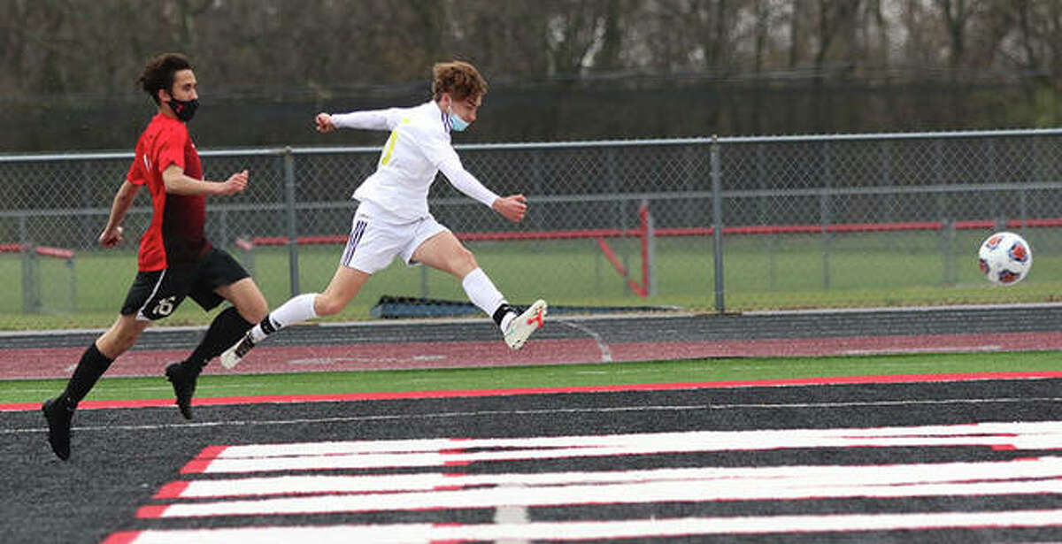 CM's Bryce Davis (right) takes a shot during a spring game against Triad. Davis, who scored 20 goals last spring, scored three goals Wednesday to lead the Eagles past Alton 4-1 in a Metro Cup Tournament game in Mascoutah.