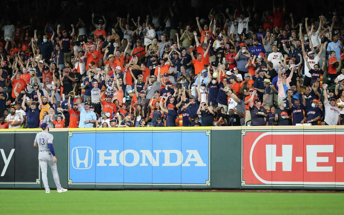 Astros fans cheer during a game against the Rangers on July 25, 2021.