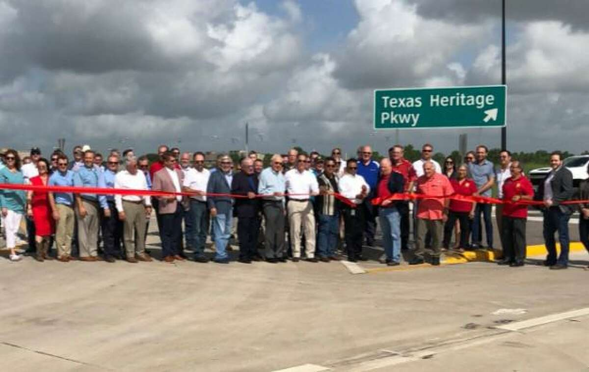 Community leaders attend a ribbon cutting for the grand opening of Texas Heritage Parkway on Aug. 21, 2021.