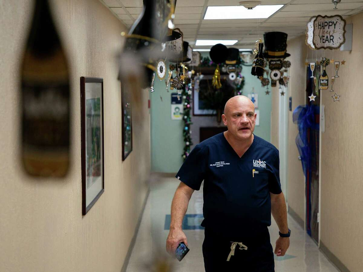 Dr. Joseph Varon, the chief medical officer at United Memorial Medical Center, walks back to the COVID-19 Intensive Care Unit onTuesday, Dec. 22, 2020, in Houston.
