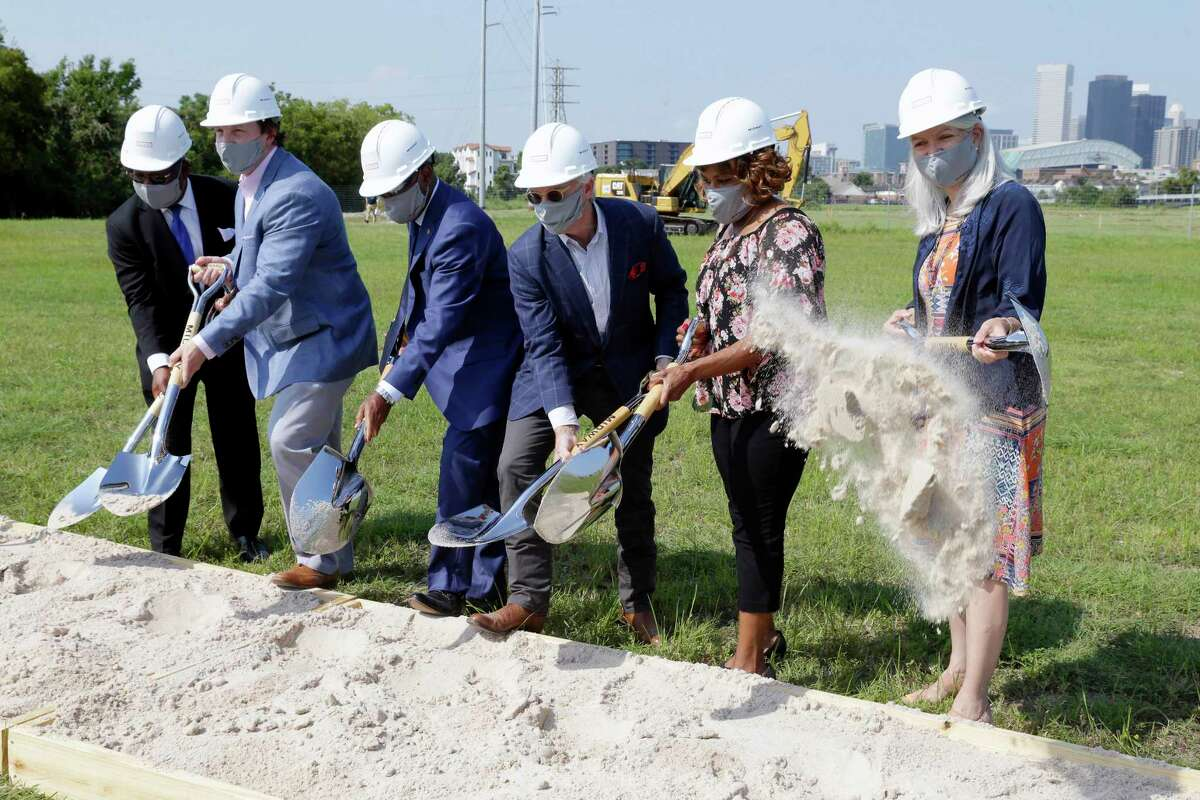 Dignitaries line up to turn the dirt during a ground breaking ceremony on the East River site of a $2.5 billion, 150 acre mixed-use development on the southern edge of Fifth Ward Thursday, Aug. 26, 2021 in Houston, TX.