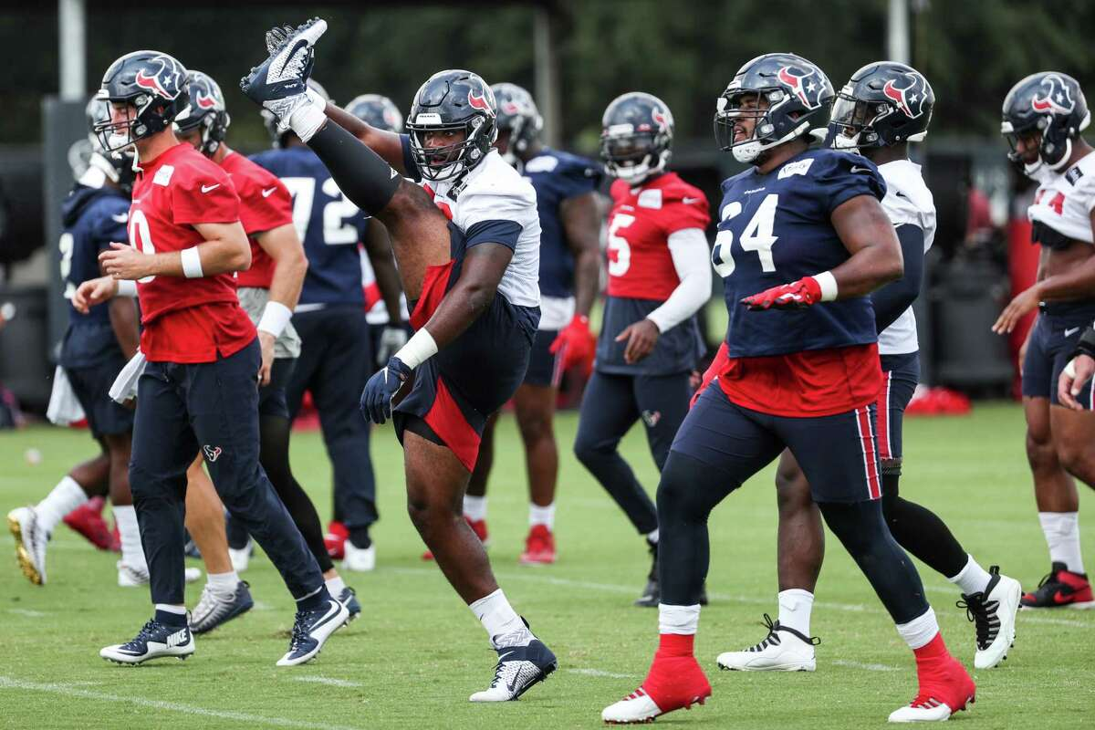 Houston Texans players warm up during an NFL training camp football practice Thursday, Aug. 26, 2021, in Houston.