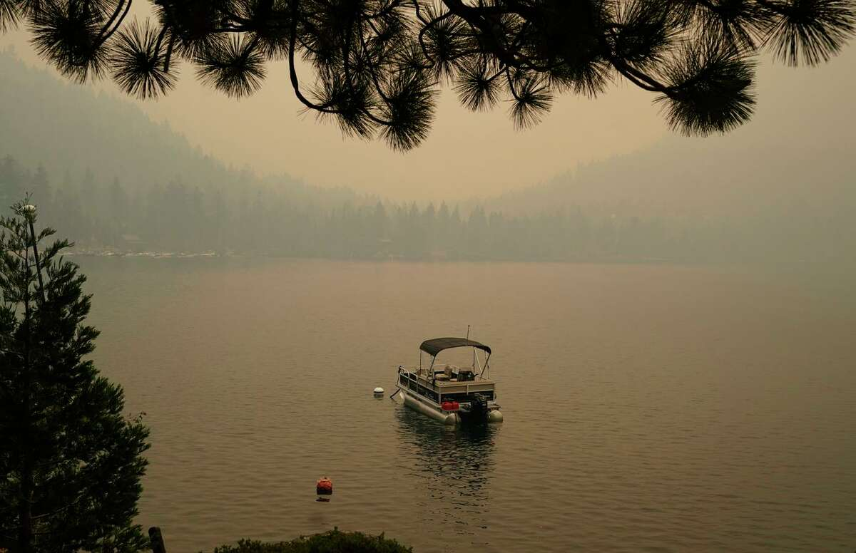 Smoke from the Caldor Fire shrouds Fallen Leaf Lake near South Lake Tahoe on Tuesday. As the Caldor Fire continued to move east toward Tahoe on Thursday morning, evacuation orders were extended to Echo Summit and the first warnings were made inside the basin.