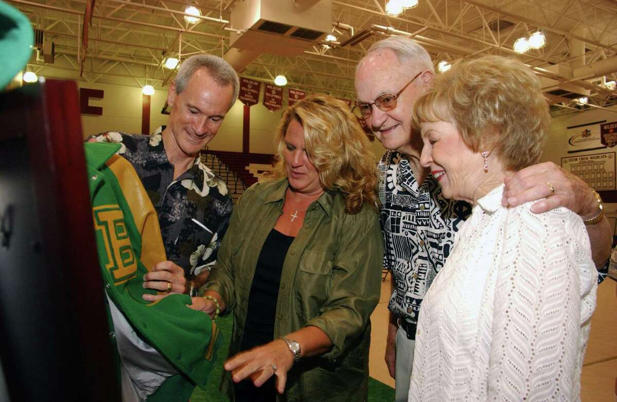 Buddy Carlisle (left to right) his wife Jenny, his dad George and mother Peggy look at Buddy's Baylor letter jacket at his retirement party in 2006 at Clear Creek High School.