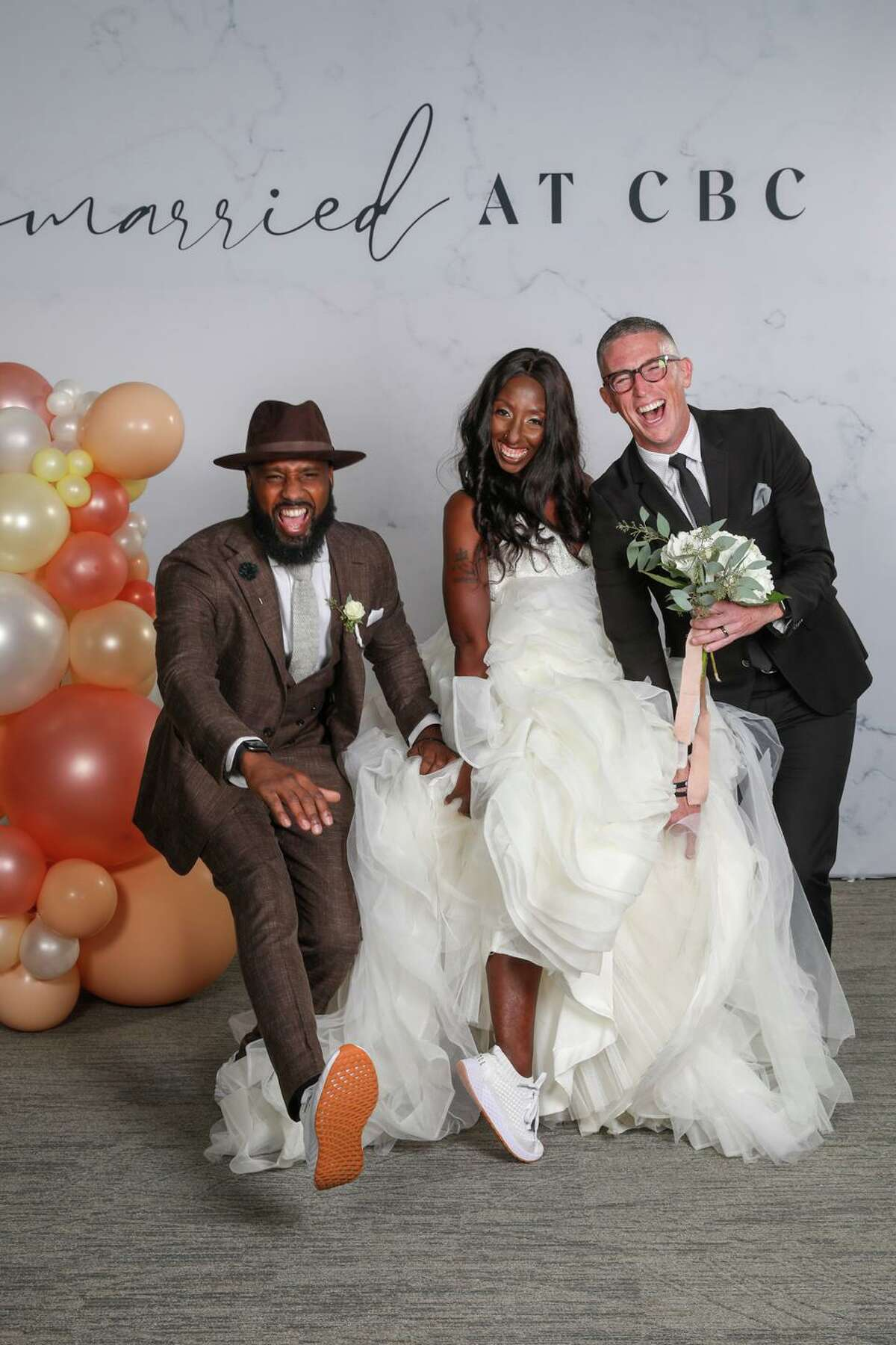 Together for seven years, JaVanka Johnson and Charles McGee got engaged on May 29, but they didn't have a clear plan of how or when they would get married. They were one of 52 couples who answered Community Bible Church Pastor Ed Newton's challenge to get married in a mass wedding on Aug. 21.