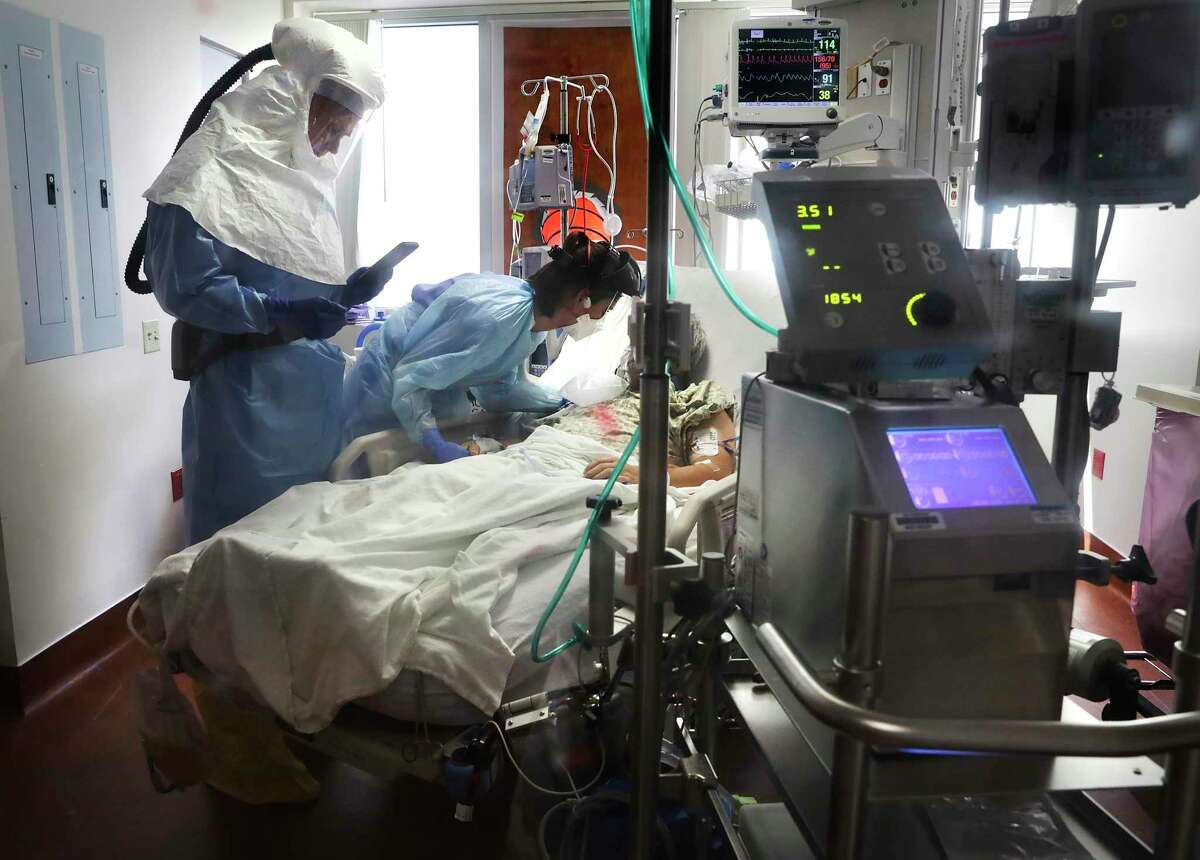A doctor and nurse care for a patient in Methodist Hospital's COVID unit in 2020. Once again, hospitals are full, and medical staff are overwhelmed. We see your care and compassion.