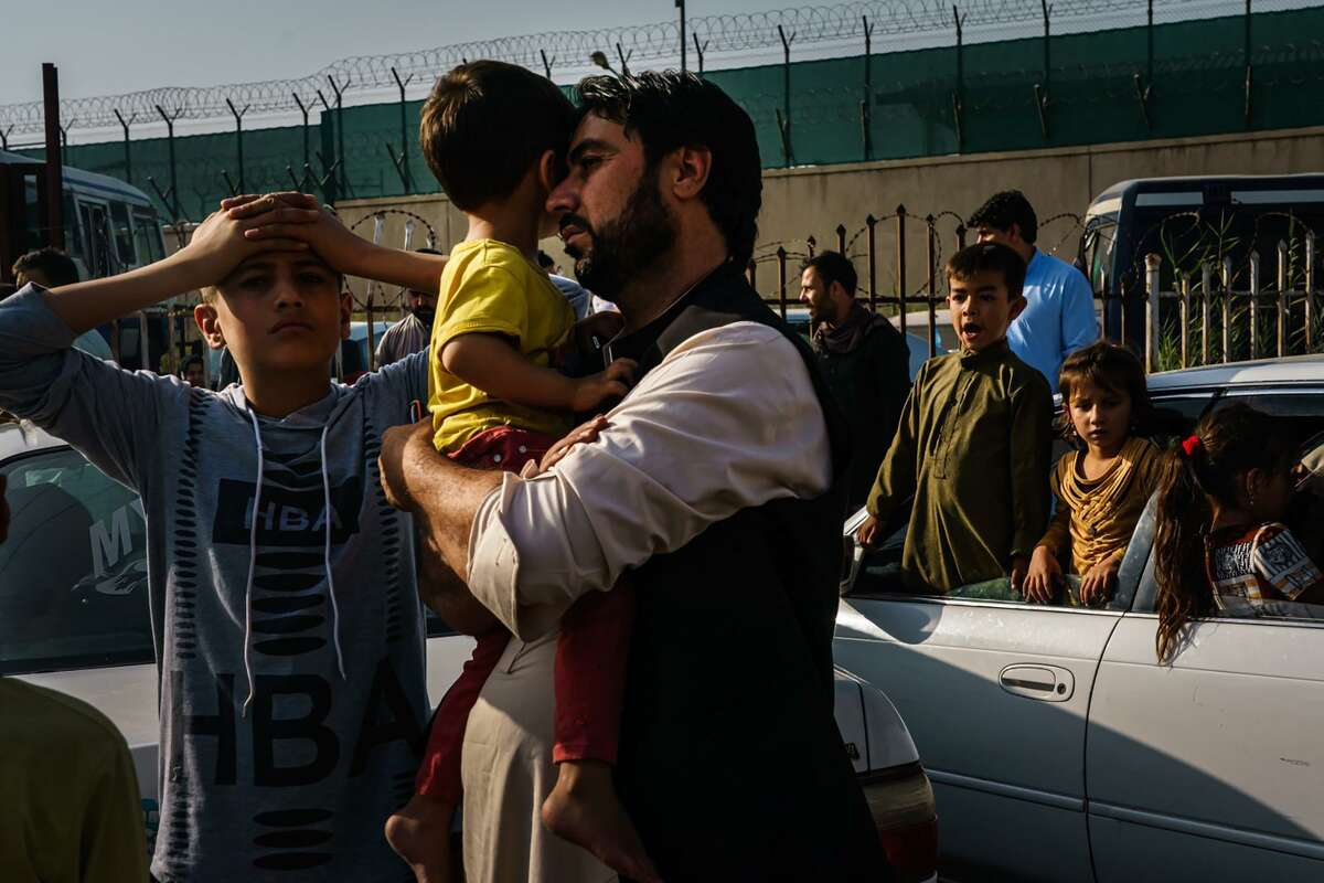 A father with two sons en route to the Kabul international airport. A reader says the heartbreaking outcome in Afghanistan was inevitable. Another says voters will remember the collapse and humanitarian crisis.