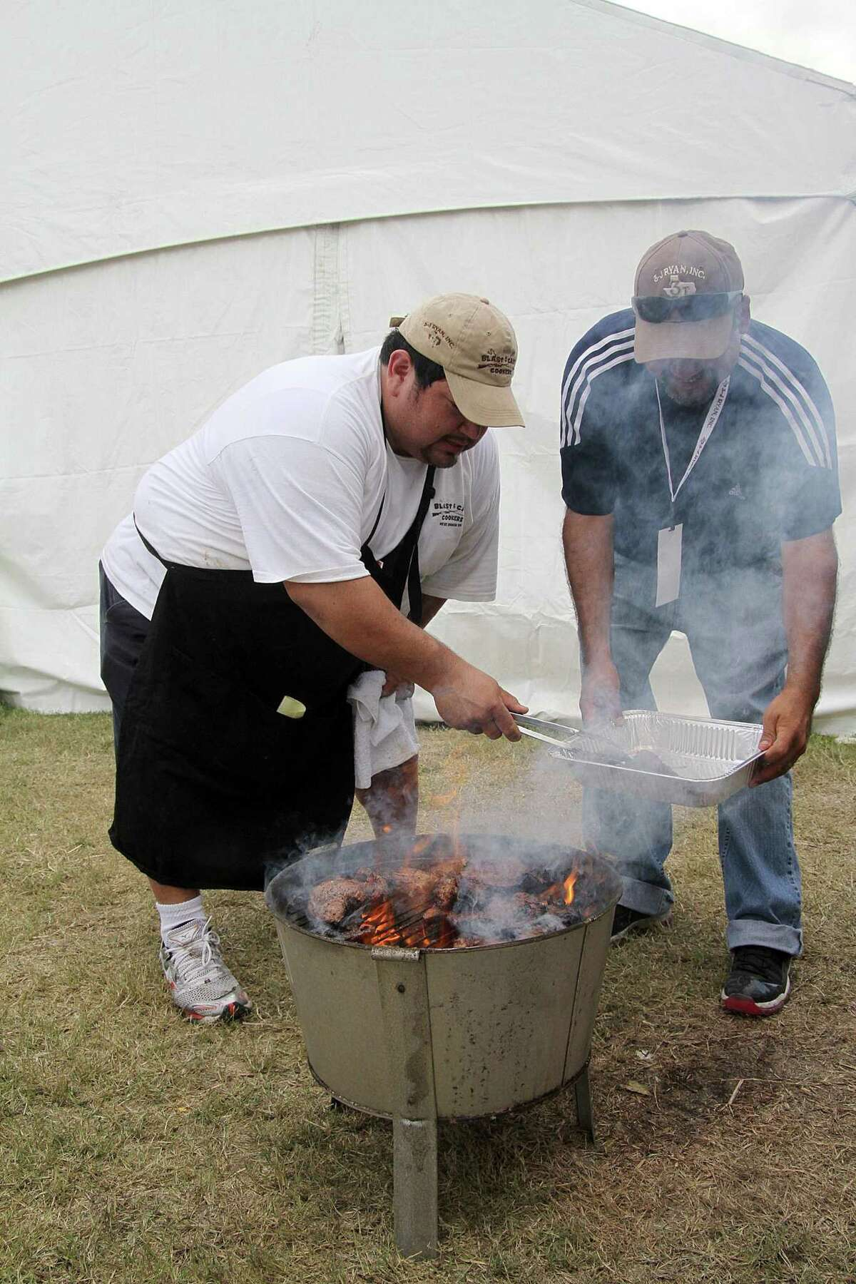 Lupe Gonzales and Manuel Casillas prepare ribeye at a previous Pasadena Livestock Show & Rodeo BBQ Cookoff. The event is set for Sept. 16-18 after being canceled last year because of the pandemic.