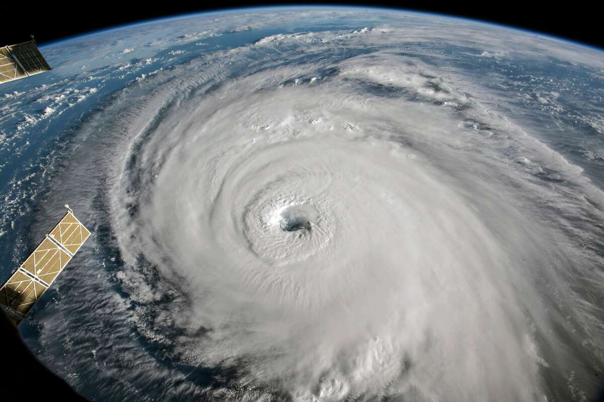 IN SPACE - SEPTEMBER 12: In this NASA handout image taken from aboard the International Space Station, shows Hurricane Florence as it travels west in the Atlantic Ocean off the coast of the U.S. on September 12, 2018. Coastal cities in North Carolina, South Carolina and Virginia are under evacuation orders as the Category 2 hurricane approaches the United States. (Photo by NASA via Getty Images)