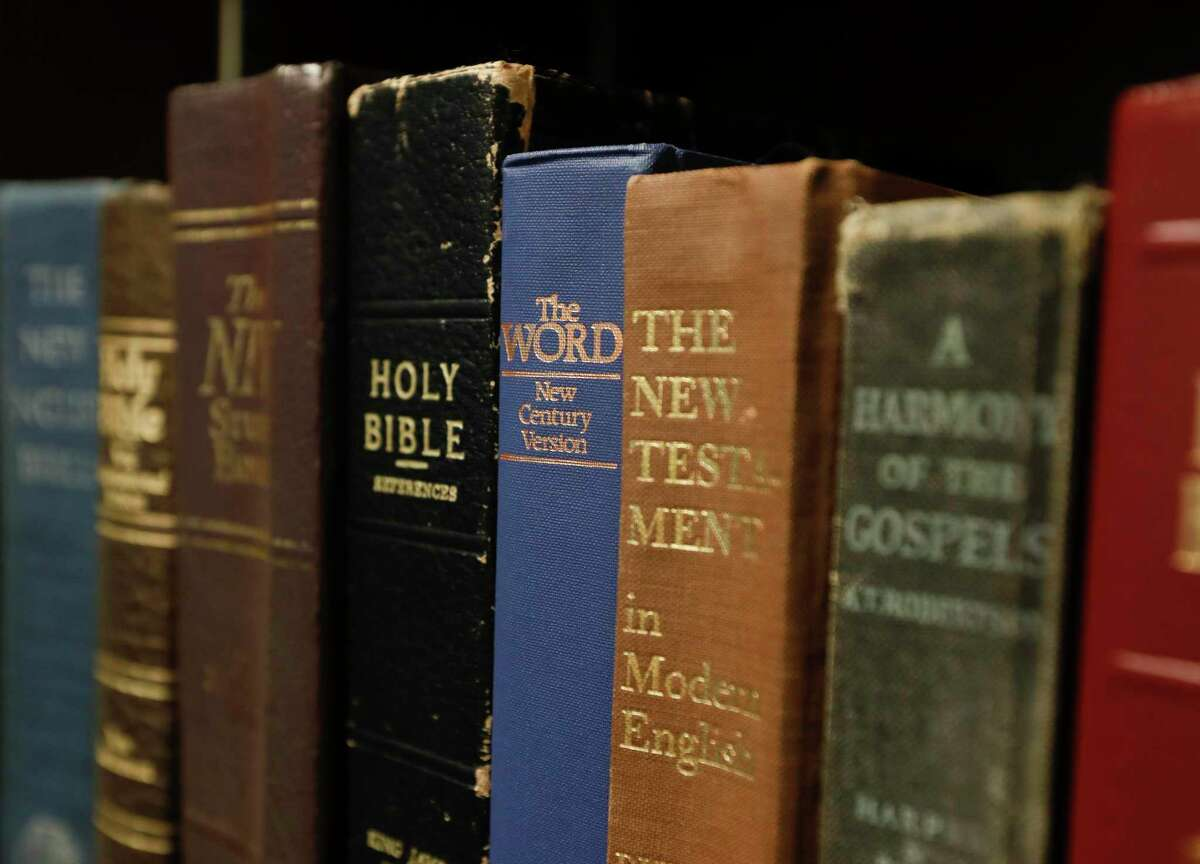 Pastor Steve Yates' extensive library is seen at his office at Conroe Church of Christ, Tuesday, Aug. 24, 2021, in Conroe.