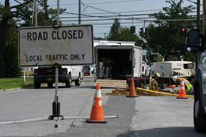 Work crews for National Grid install new natural gas pipe lines at South Street at and Second Avenue on Thursday, Aug. 26, 2021, in Mechanicville, N.Y.