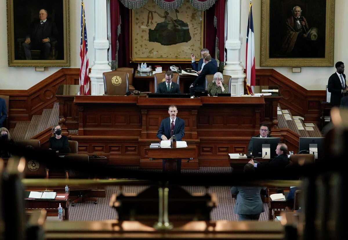 Texas State Rep. Andrew Murr, R-Kerrville, center, answers questions of fellow lawmakers as they debate voting bill SB1 in the House Chamber at the Texas Capitol, Thursday, Aug. 26, 2021, in Austin, Texas.