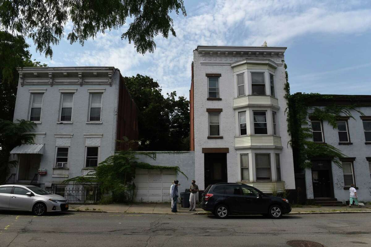 Fifth Avenue buildings at Federal Street next to Bethany Baptist Church that would be demolished if a proposed apartment complex before the city Planning Commission is approved on Thursday, Aug. 26, 2021, in Troy, N.Y.
