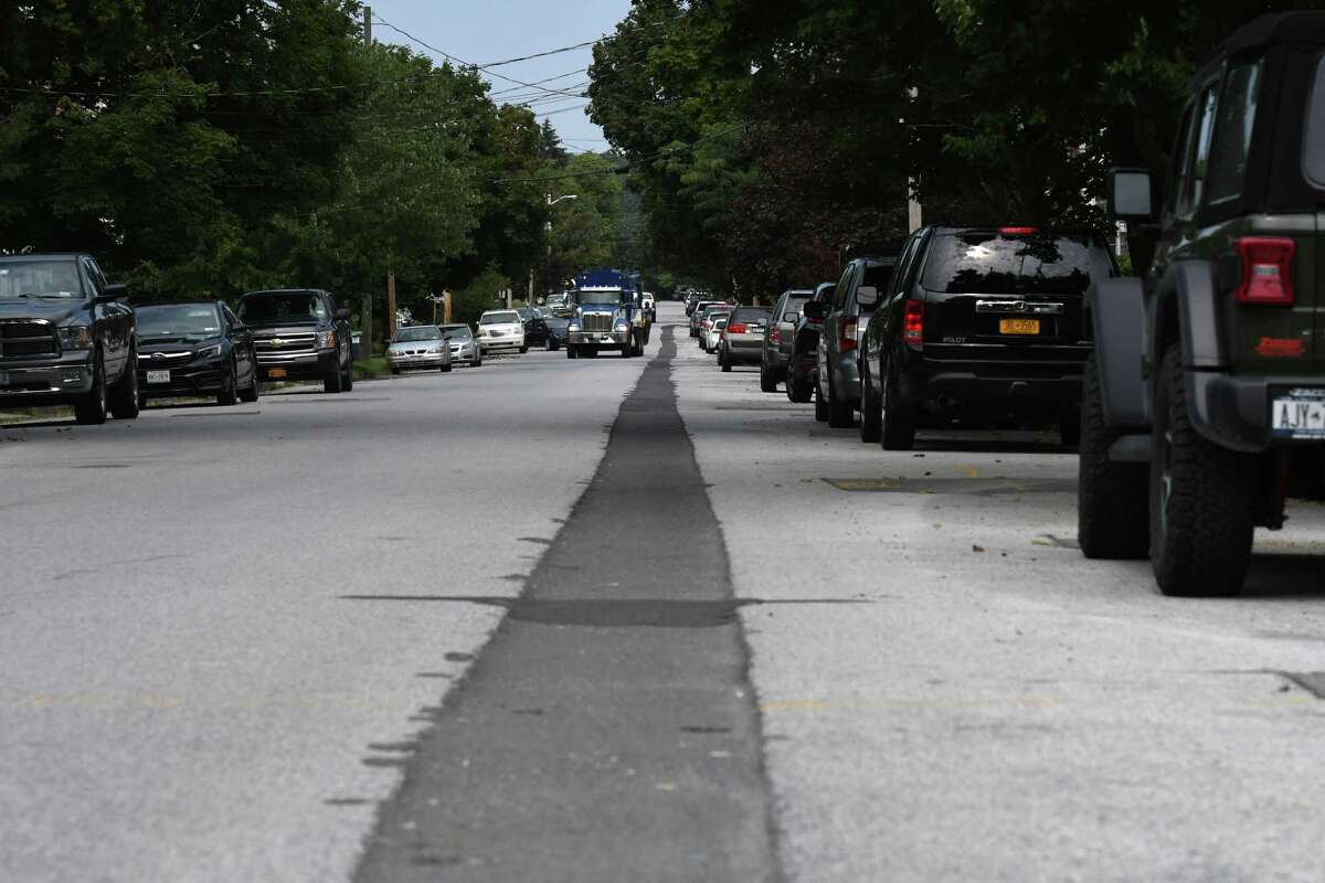 A channel cut for new natural gas lines runs down Third Avenue as National Grid engages in a major natural gas pipe replacement project on Thursday, Aug. 26, 2021, in Mechanicville, N.Y. The city bid on the repaving project and won, and will stretch the funds to entirely repave each street.