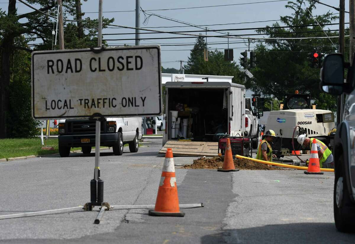 Work crews for National Grid install new natural gas pipe lines at South Street and Second Avenue on Thursday, Aug. 26, 2021, in Mechanicville, N.Y.