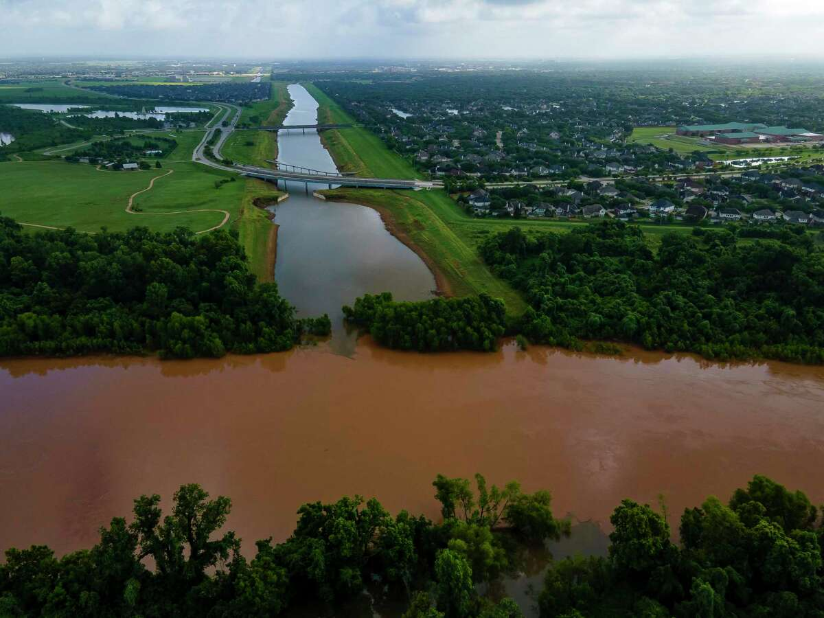 Levees along Ditch H protect Sugar Land neighborhoods north of the Brazos River, shown June 24, 2021.