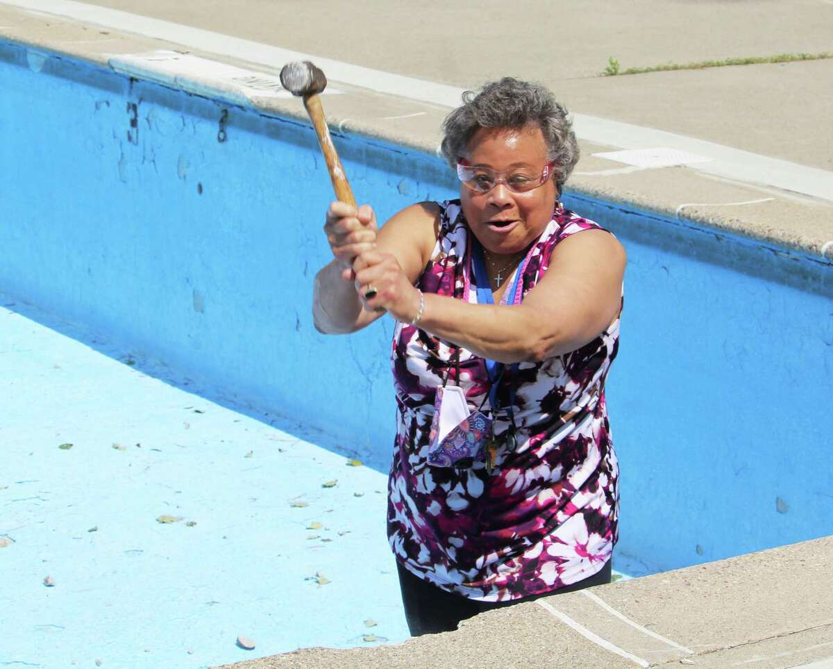 """Middletown Director of Equal Opportunity & Diversity Management Faith Jackson takes part in the """"smash party"""" at Veterans Memorial Pool Thursday. She called the pool her childhood """"stomping ground."""""""