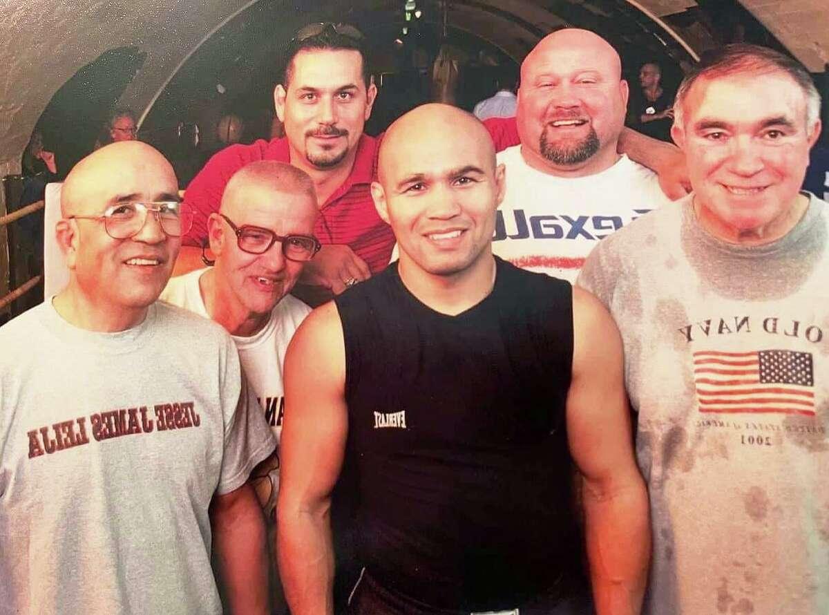 "Jesse Leija, from left, Jose Souza, Johnny Leija, San Antonio boxer ""Jesse"" James Leija, Ed Cosner and Leo Zuniga gather for a photo during a workout session."