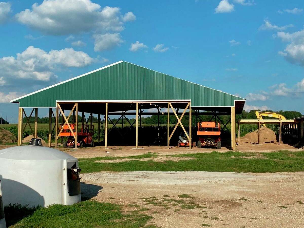The new barn being built on the Carmichael farm inHersey will be used to implement an automatic feeding systemtoreduce the amount of labor and time it takes to feed and manage a large number of baby calves. (Courtesy/Christina Carmichael)