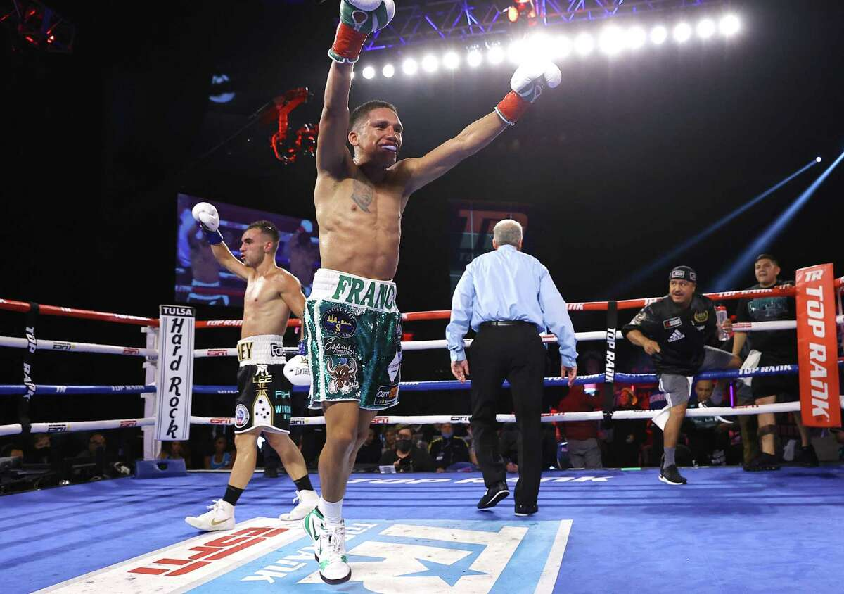 Joshua Franco (R) is victorious as he defeats Andrew Moloney (L) for the WBA super flyweight championship at Hard Rock Hotel & Casino Tulsa on August 14, 2021 in Catoosa, Oklahoma.