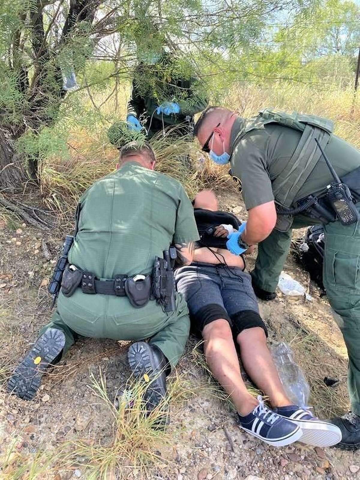 U.S. Border Patrol agents are seen aiding a lost individual. He was later taken to a local hospital for further treatment.