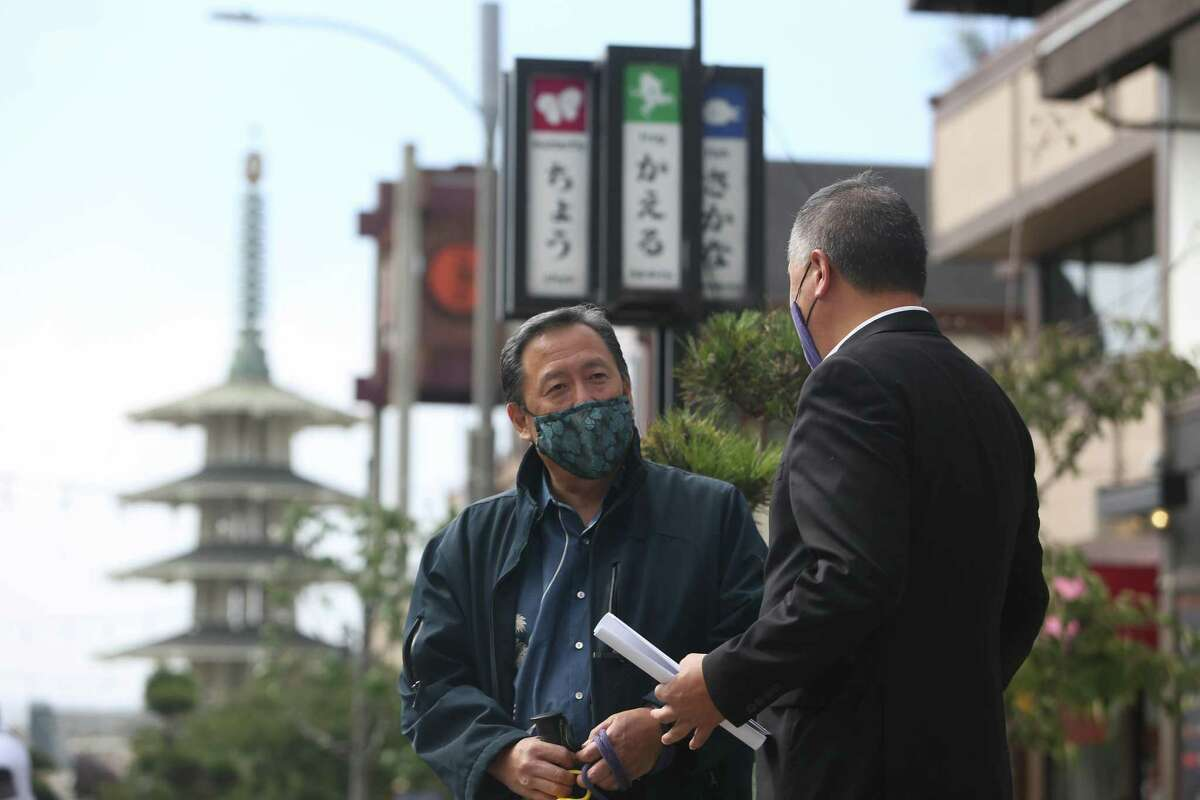 Paul Osaki (left), executive director at Japanese Cultural and Community Center of Northern California, talks with Assembly Member Phil Ting in Japantown.