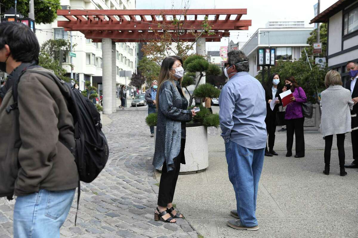 Linda Mihara, retail director of the Paper Tree, visits with Paul Lanier, son of sculptor Ruth Asawa, in Japantown after a news conference announcing $5 million in state funding for the repair and upgrade of Buchanan Mall.