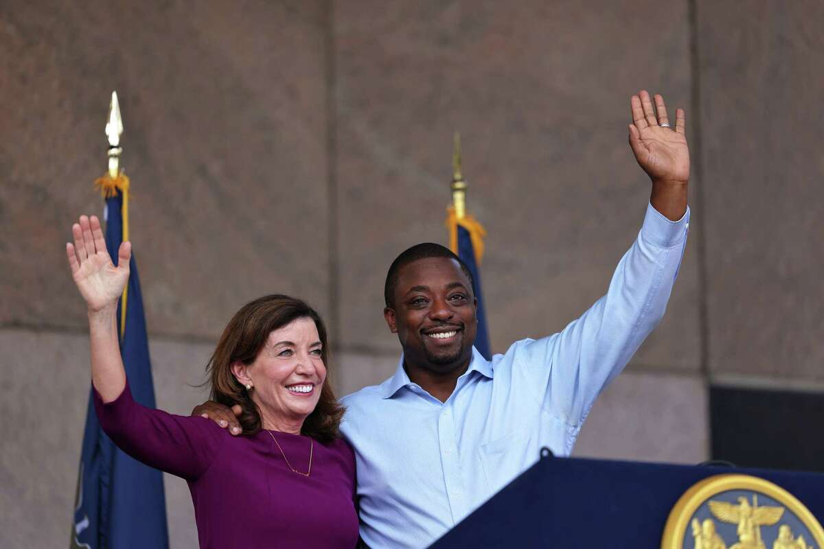 NEW YORK, NEW YORK - AUGUST 26: New York Gov. Kathy Hochul and State Senator Brian Benjamin wave at the crowd during a press conference announcing him as her Lt. Governor on August 26, 2021 in New York City. Senator Benjamin, who placed fourth in the Democratic primary for city comptroller earlier this year, will replace Hochul who was sworn in as Governor this week after the resignation of former Gov. Andrew Cuomo. Senator Benjamin has been a lead sponsor and advocate for criminal and police reforms that includes the Eric Garner Anti-Chokehold Act and the Less is More Act, which restricts the use of incarceration for non-criminal technical parole violations. He has also been a proponent of affordable housing.