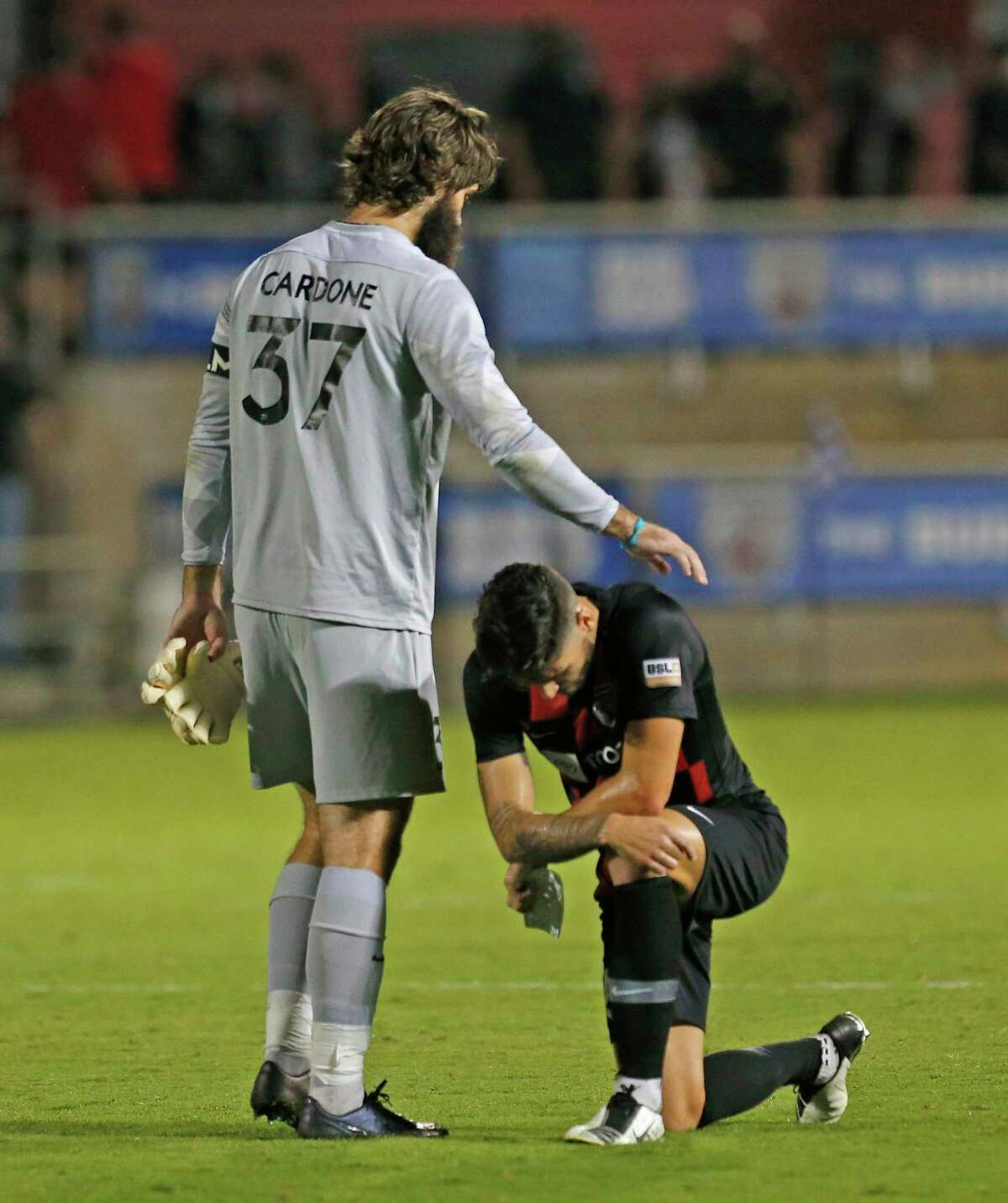 SAFC goalie Matthew Cardone consoles SAFC Mitchell Taintor after they lost in OT 1-0. San Antonio FC vs. New Mexico United in Western Conference Quarterfinal match on Saturday, October 10, 2020 at Toyota Field.