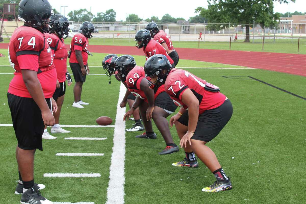 Westfield offensive line coach Alfredo Morales working with the O-Line during fall camp.