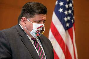 In this Sept. 21, 2020 file photo, Gov. J.B. Pritzker appears at a news conference wearing a mask. On Thursday Pritzker announced the statewide mask mandate indoors will return Monday, with COVID-19 vaccinations required for all educators and health care professionals.