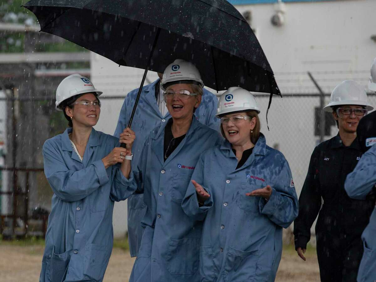 """U.S. Secretary of Energy Jennifer M. Granholm, center, tours an Air Liquide hydrogen facility in La Porte. Granholm announced her own """"Earthshot"""" to reduce the cost of clean hydrogen."""