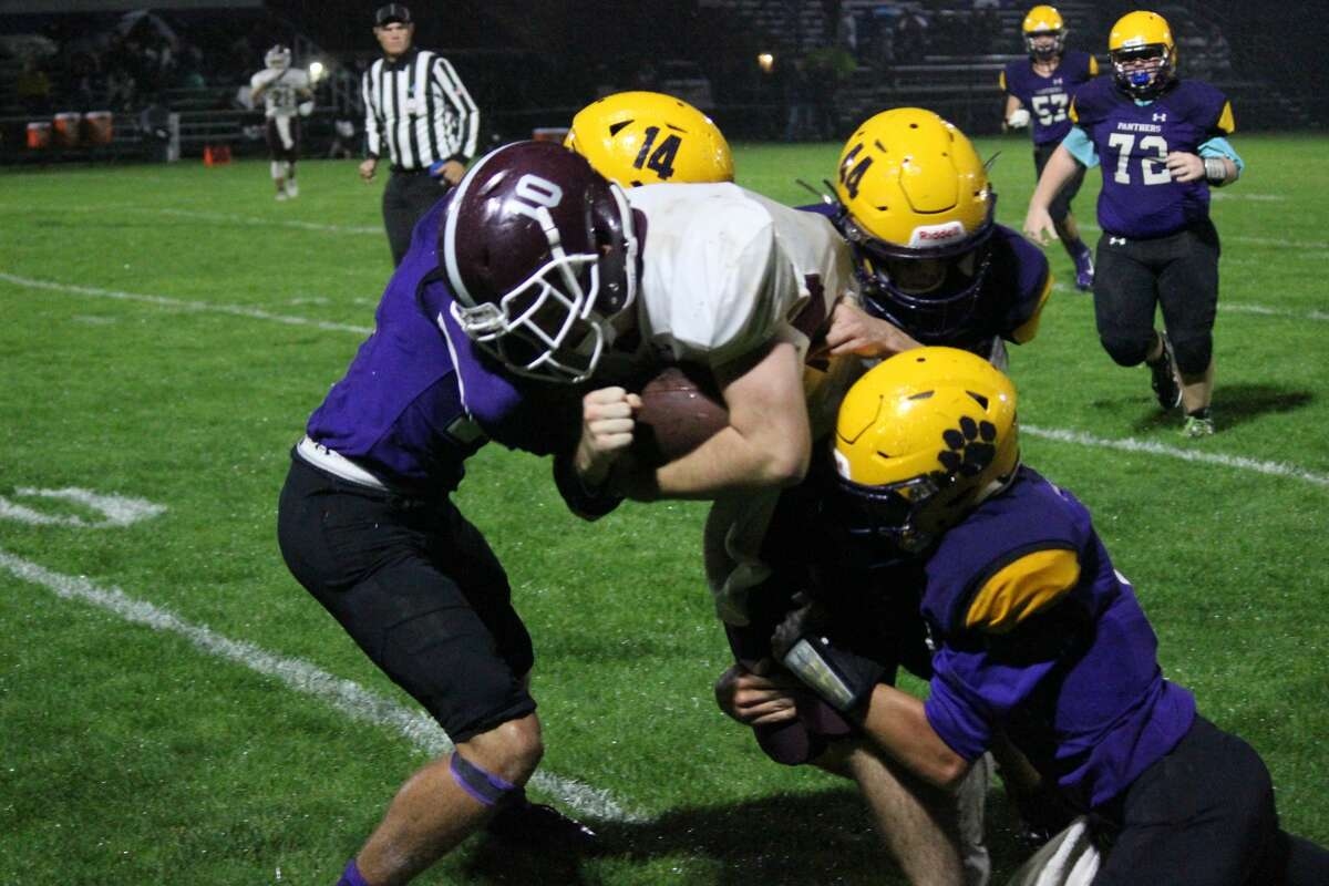 The Frankfort Panthers tackle a member of the Charlevoix Red Rayders to the ground in 2019.