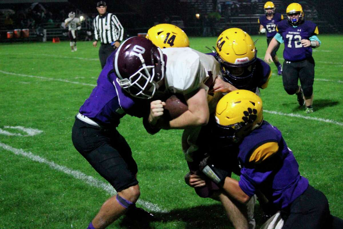 The Frankfort Panthers tackle a member of the Charlevoix Red Rayders to the ground in 2019. (File Photo)