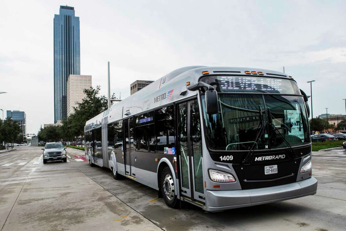 A Metropolitan Transit Authority Silver Line bus rolls along Post Oak in the Galleria on Aug. 26, 2021 in Houston. Metro is committing to buying zero-emission buses by 2030, but mostly runs diesel buses, including the new 60-foot buses that operate the Silver Line through Uptown.