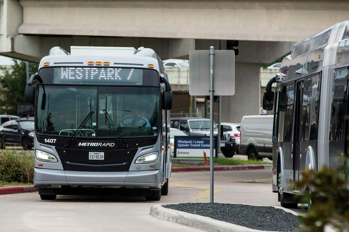 A Metropolitan Transit Authority Silver Line bus turns into the Westpark/Lower Uptown Transit Center near the Galleria on Aug. 26, 2021 in Houston. Metro is committing to buying zero-emission buses by 2030, but mostly runs diesel buses, including the new 60-foot buses that operate the Silver Line through Uptown.