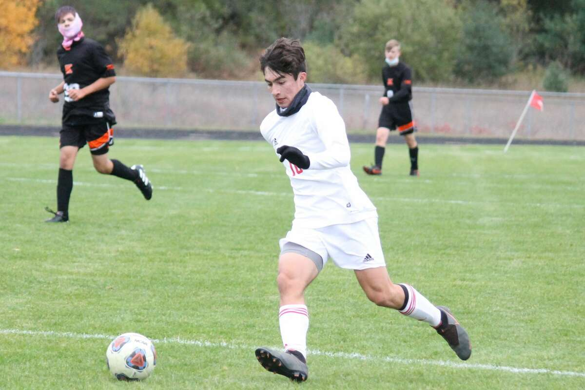 Kevin Hubbell sprints down the field while dribbling the ball, intent on scoring a goal for Benzie High School.