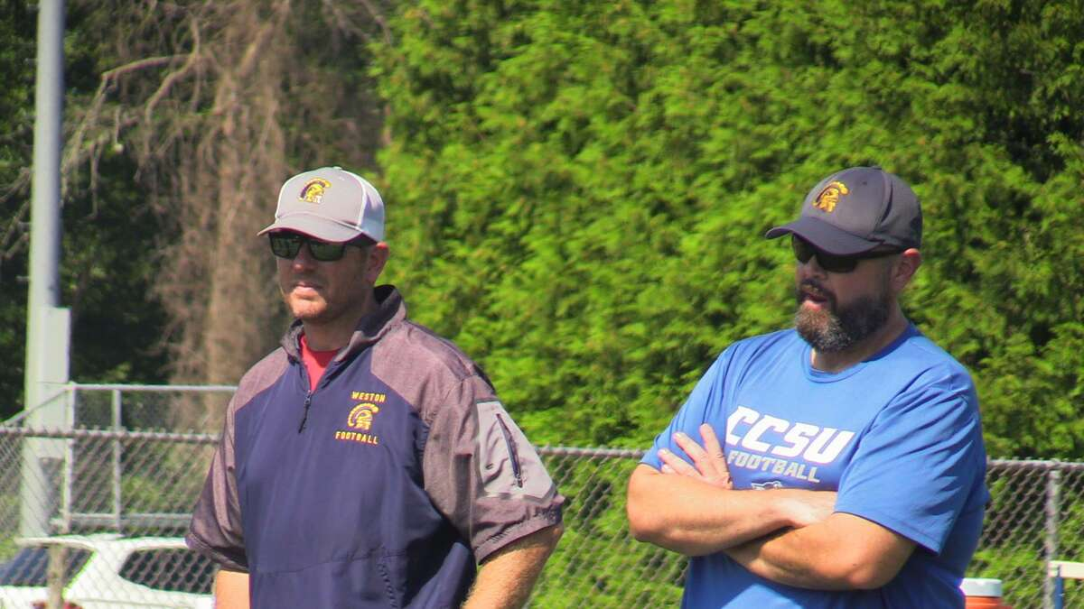 Weston assistant football coach Dan Passarelli, right, is back on the sidelines with head coach Dan Hassett after aggressive treatment against esophageal cancer.