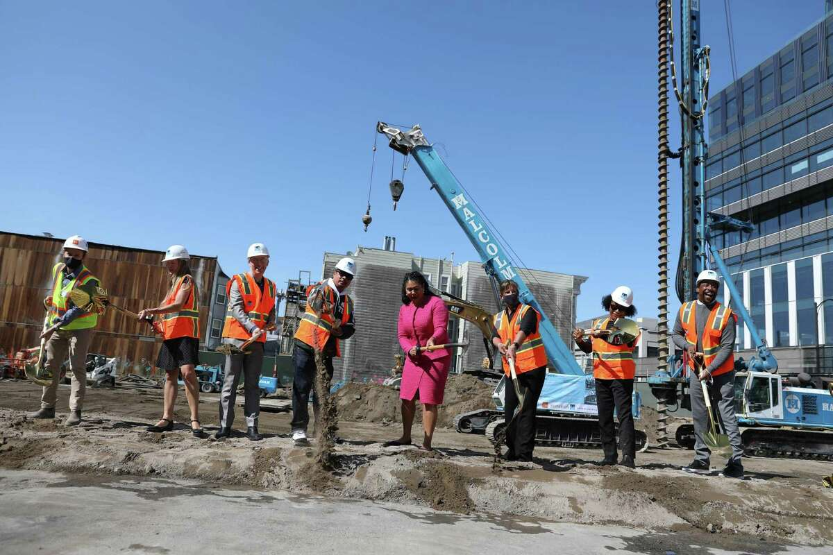 Mayor London Breed (fourth from right) and other officials during the ground breaking ceremony at 921 Howard Street on Thursday in San Francisco. 921 Howard will have over 200 affordable housing units for people with low to moderate income.