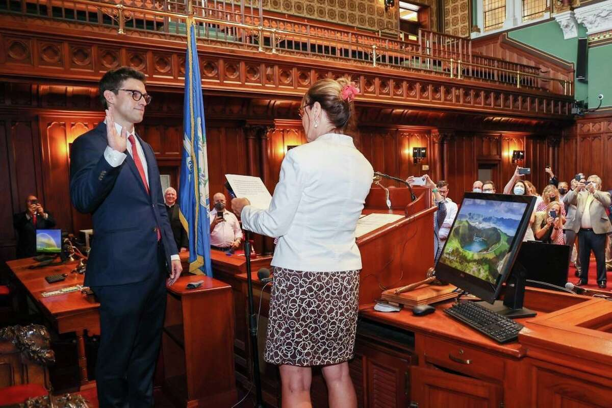Ryan Fazio, a Republican from Greenwich, is sworn in by Secretary of the State Denise Merrill as the new senator in the 36th District representing Greenwich and part of Stamford and New Canaan. The ceremony was held in the Senate chamber at the Capitol in Hartford on Thursday, Aug. 26, 2021.