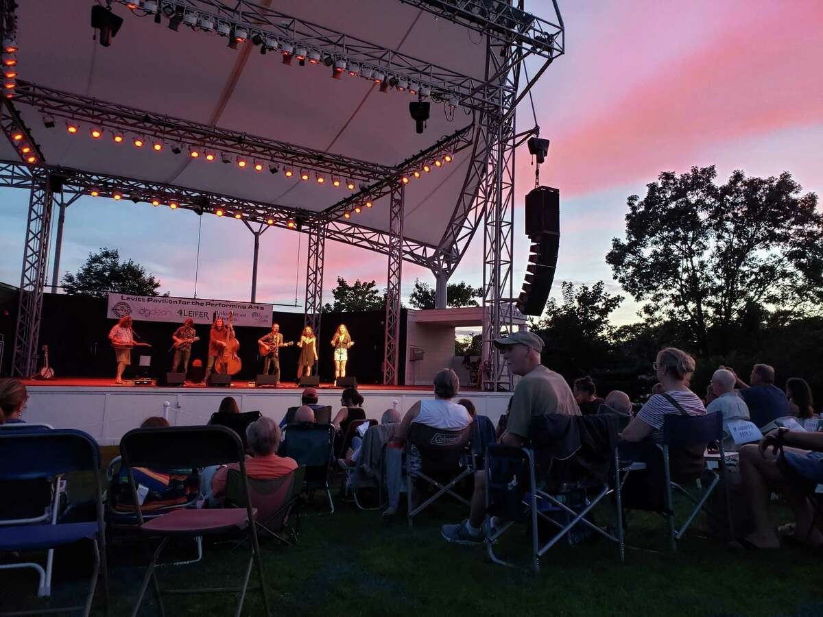 A sunset as the six piece folk/pop band Buffalo Rose played on the stage at Westport's Levitt Pavilion.