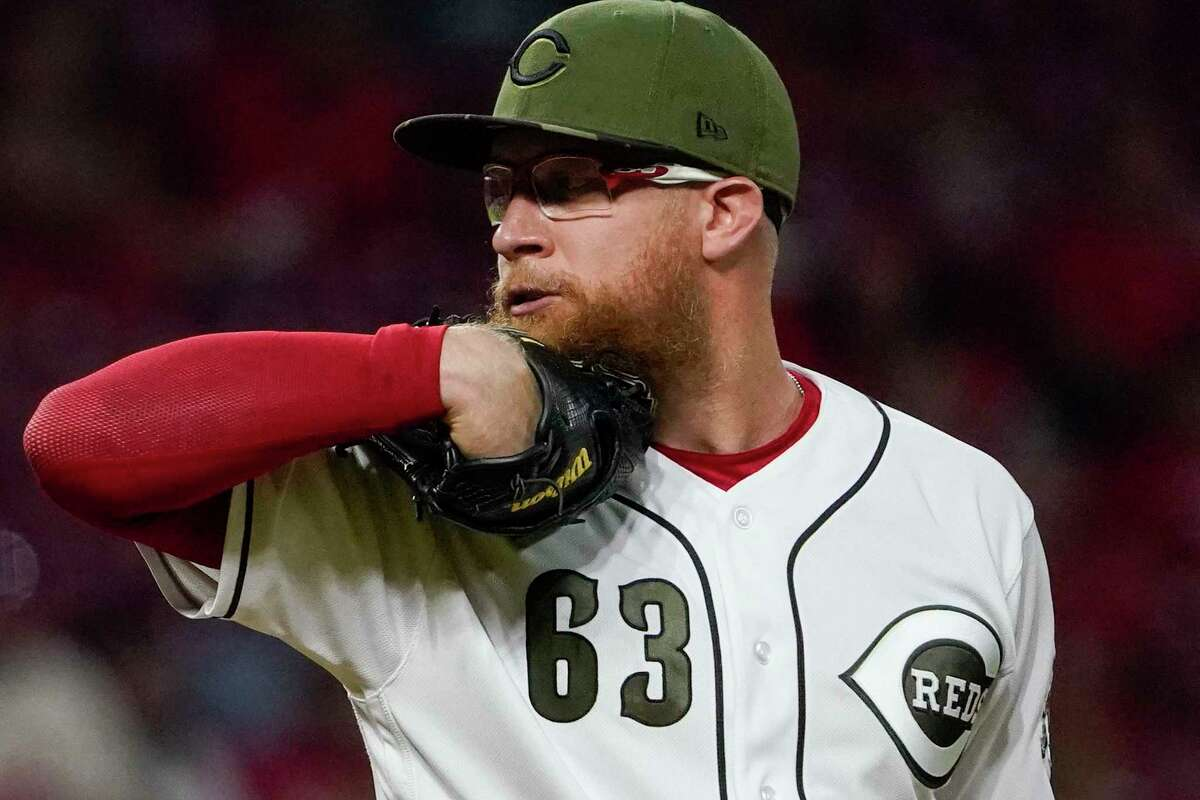 Cincinnati Reds relief pitcher Sean Doolittle (63) prepares to throw his 500th career strikeout during the ninth inning of a baseball game against the Pittsburgh Pirates in Cincinnati on Friday, Aug. 6, 2021. (AP Photo/Jeff Dean)