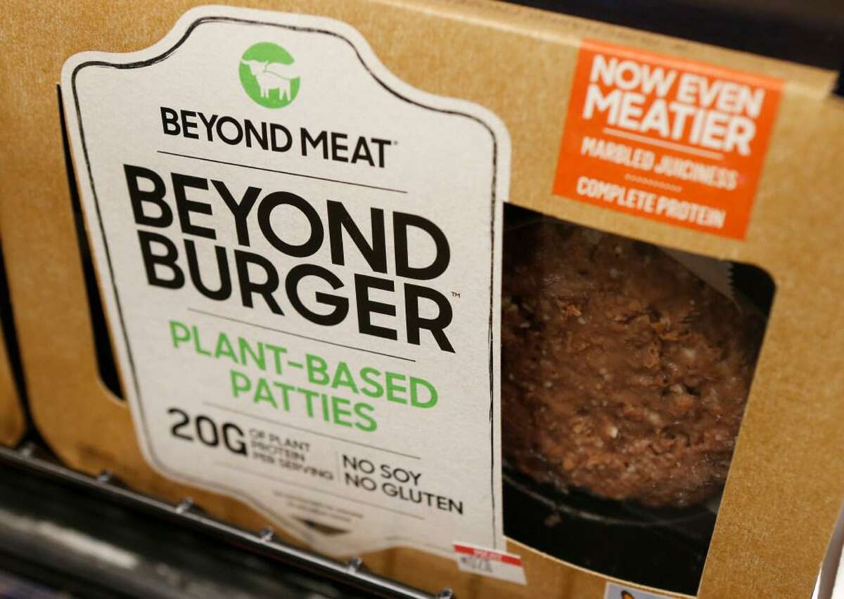 In this June 27, 2019, file photo a meatless burger patty called Beyond Burger made by Beyond Meat is displayed at a grocery store in Richmond, Va. Beyond Meat reports financial earns Monday, July 29.