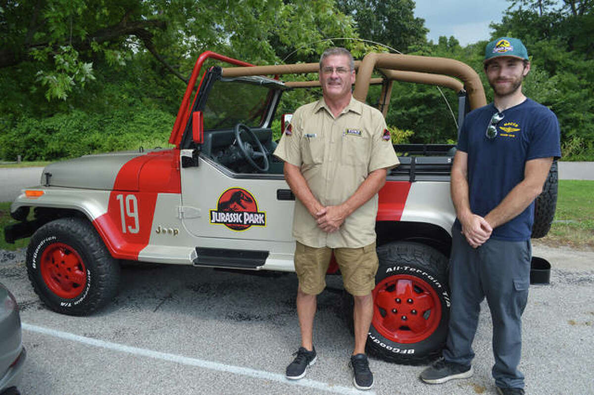 A Jurassic Park recreation Jeep, owned by Jacob Schultz, right, of Bethalto and designed by Tony Goodrich of Bunker Hill, was among the vehicles on display Thursday at the media briefing for the second annual Kicks on 66 Car Show, scheduled for Saturday, Sept. 11 at Edwardsville American Legion Post 199.