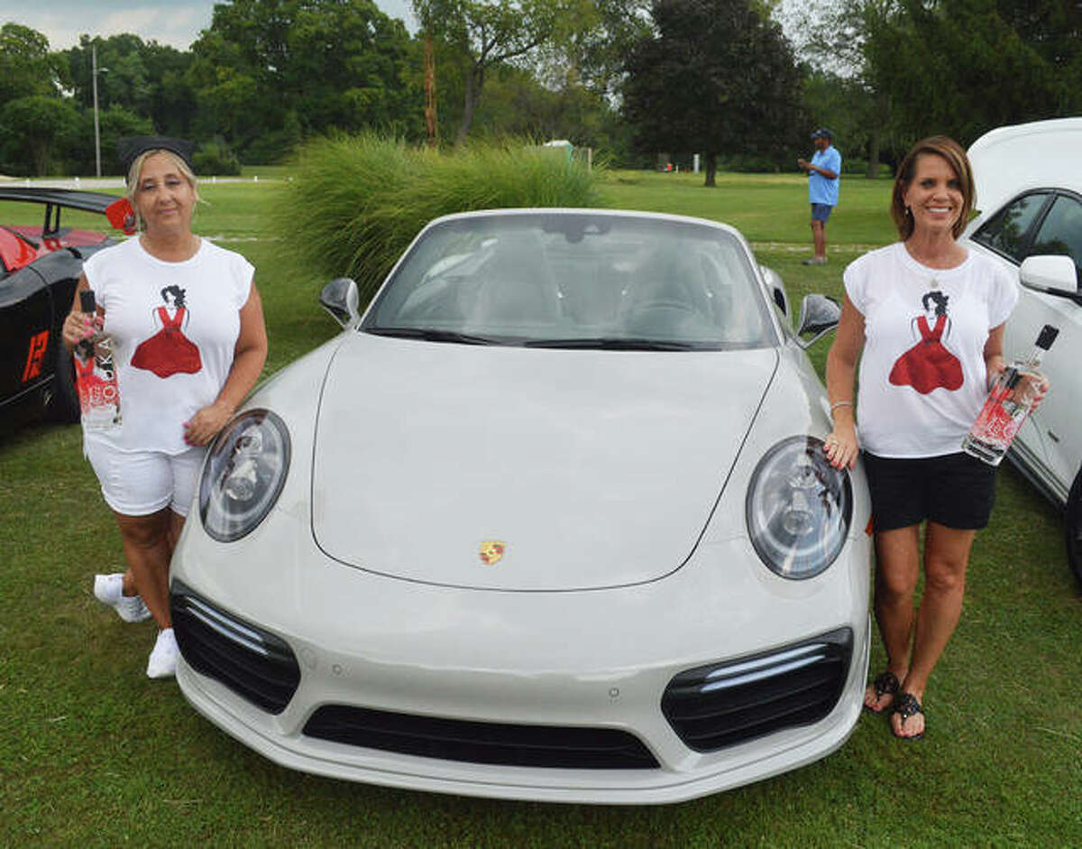 Denise Arendell, left, of Edwardsville and Christa Guilbeault of Glen Carbon posed with the official Social Grace Vodka car, a 2020 Porsche 911 Turbo S, at Thursday's media briefing for the second annual Kicks on 66 Car Show, scheduled for Saturday, Sept. 11 at Edwardsville American Legion Post 199.