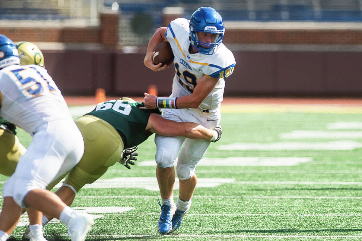 Midland's Drew Barrie carries the ball during the Chemics' game against Traverse City West Thursday, Aug. 26, 2021 at Michigan Stadium in Ann Arbor. (Katy Kildee/kkildee@mdn.net)